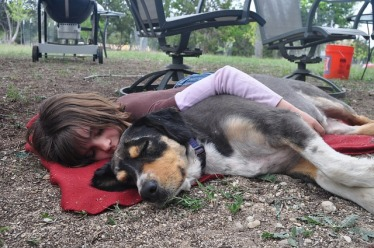 Little girl and her special pet napping